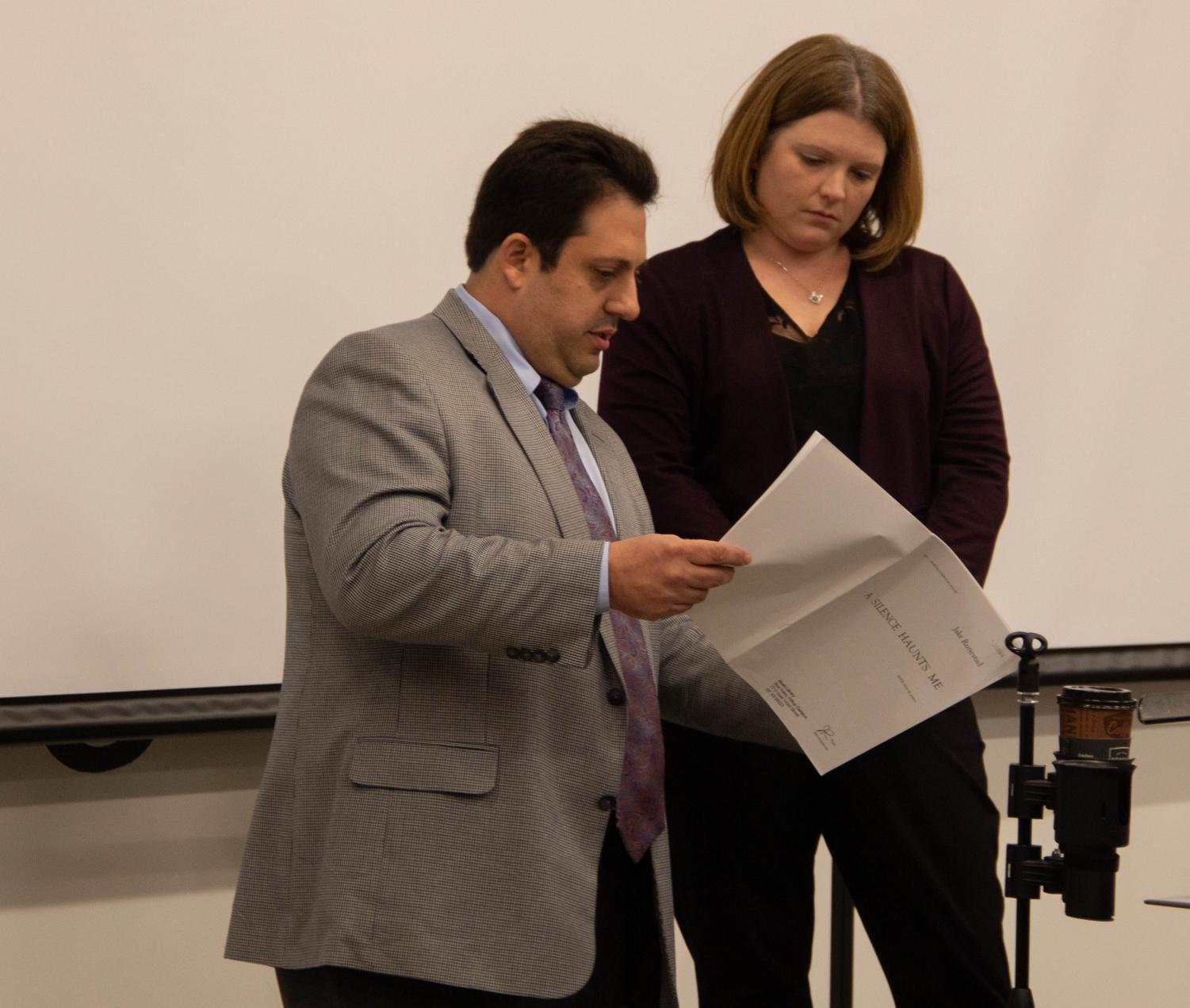 Choir director Beth Richey-Sullivan and Director of Chorale Studies at William Jewel College, Anthony Maglione, look at sheet music during second hour Chorale.