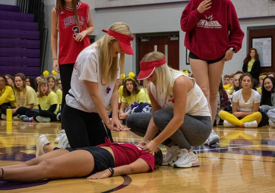 Juniors Savannah Bridges, Mary Hungerford and Alison Arrigueno perform together during the junior spirit skit, on Oct. 10.
