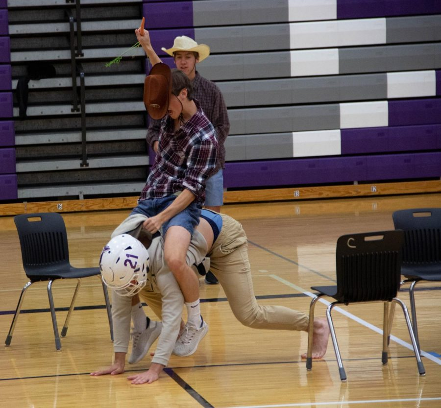 Juniors Reece Trusdale and Leo Clennan perform during the junior class dance, on Oct. 8.