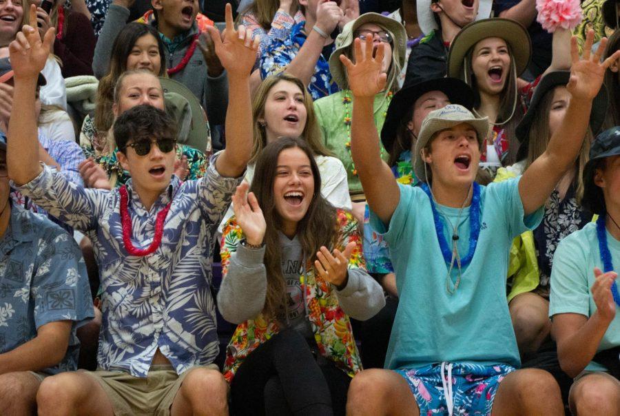 Seniors Sam Stewart, Sarah McGuyer, Drew Coble and Adalyn Evans cheer in the crowd during spirit skits on Oct. 7.