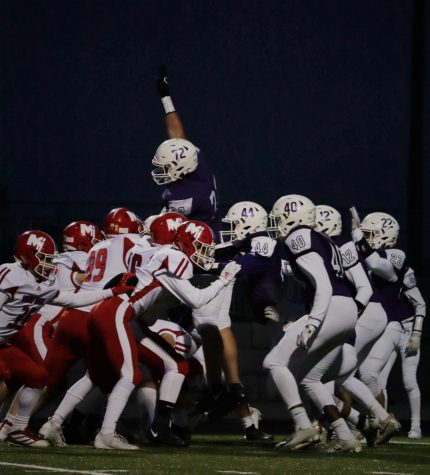 Senior Danny Robinson jumps with his hand in the air during the varsity football game against Bishop Miege, on Oct. 24.