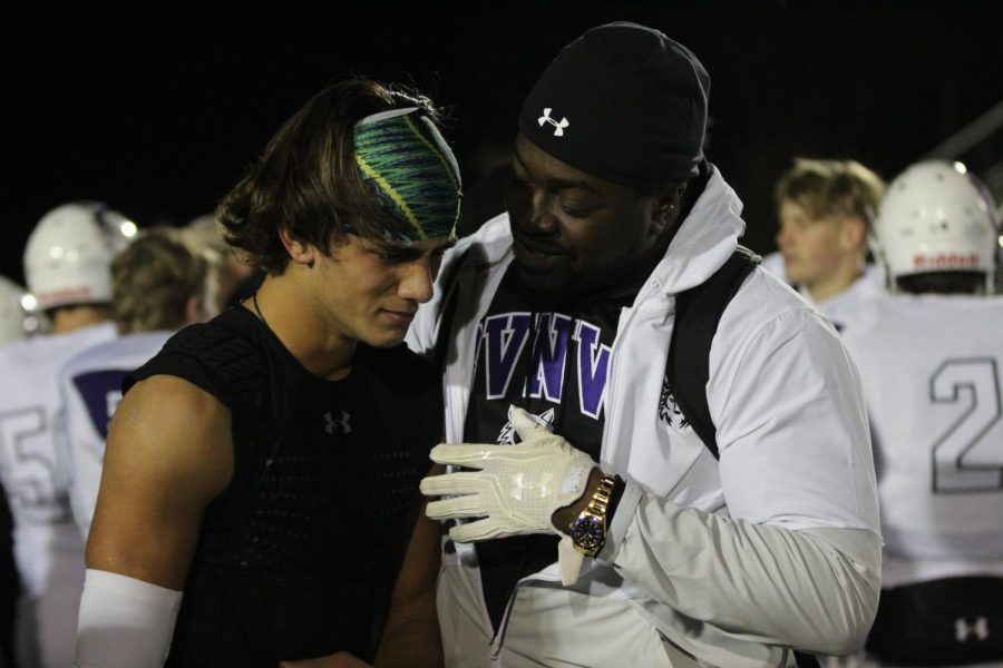 Coach David Faggett and senior Evan Ranallo talk with one another after the varsity football game, on Nov. 1.