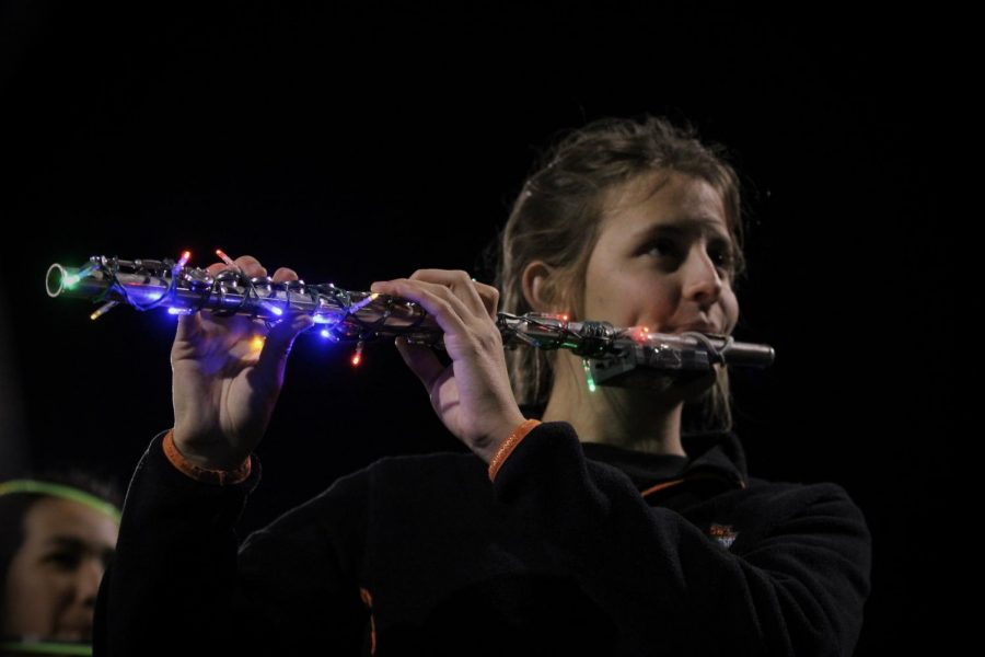 Junior Amy Winkler plays the flute during the Glow Show on Nov. 2 at the DAC.