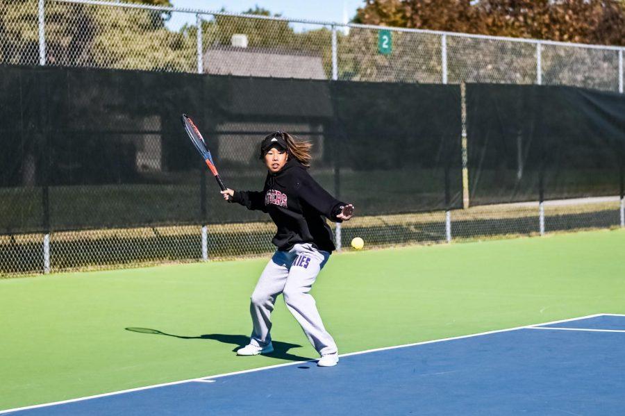 Senior Alisa Prinyarux swings to hit the tennis ball during tennis regionals, on Oct. 15.