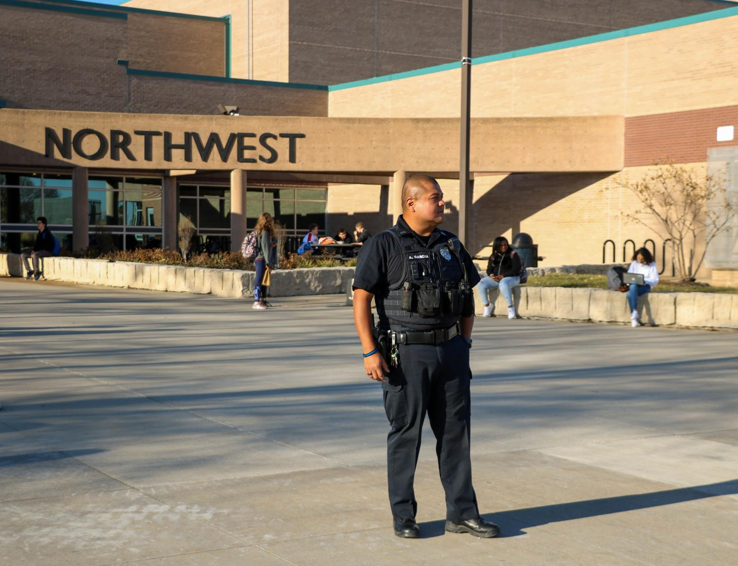 BVNW SRO Anthony Garcia stands outside the main entrance for dismissal Monday. There was an increased police protection at BVNW in reaction to a threat against the school.