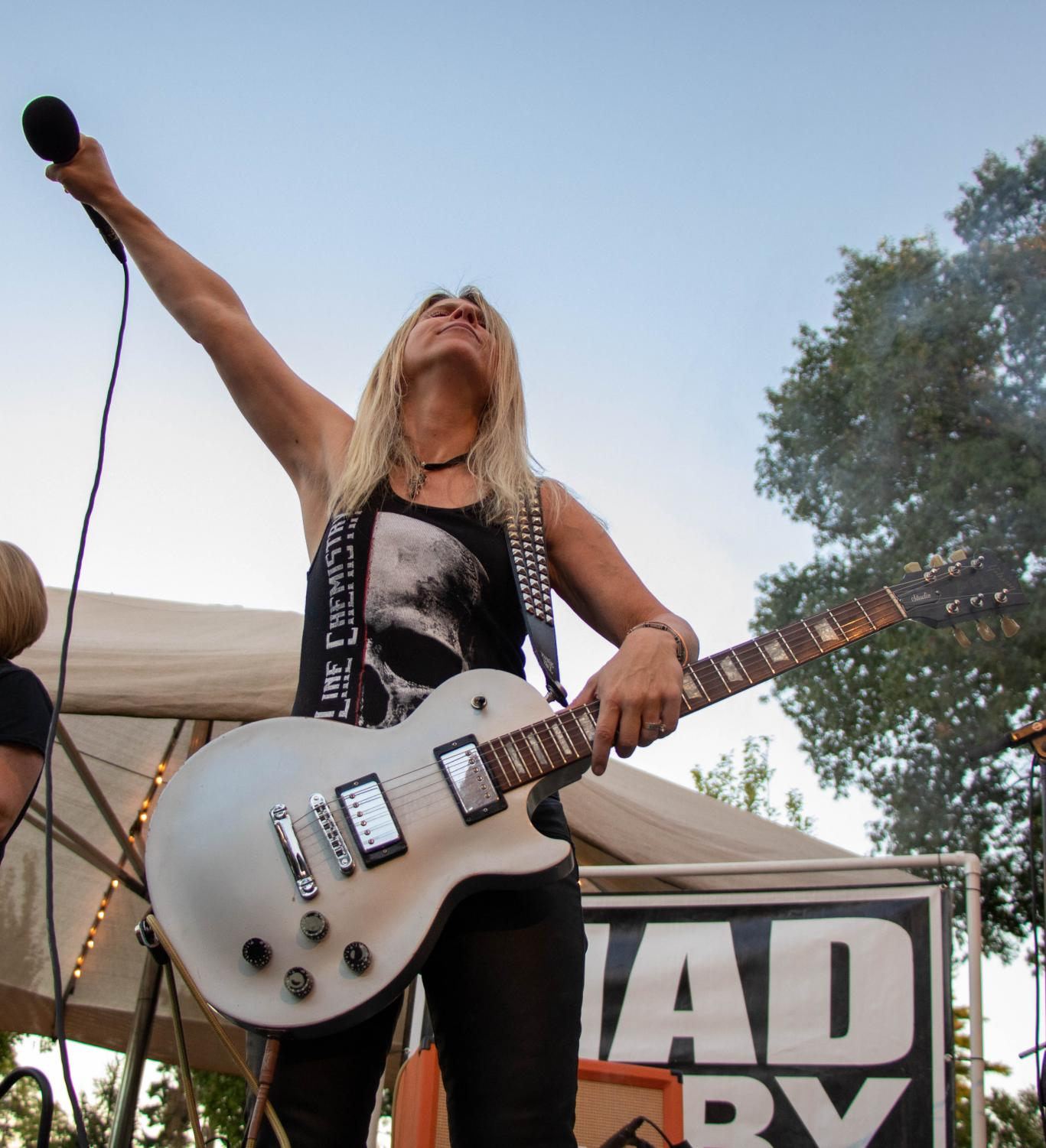 Left: Jennifer Roswold raises the microphone into the air while performing at Starlight Theatre Oct. 8. Roswold said opening for Joan Jett has been a dream of hers.
