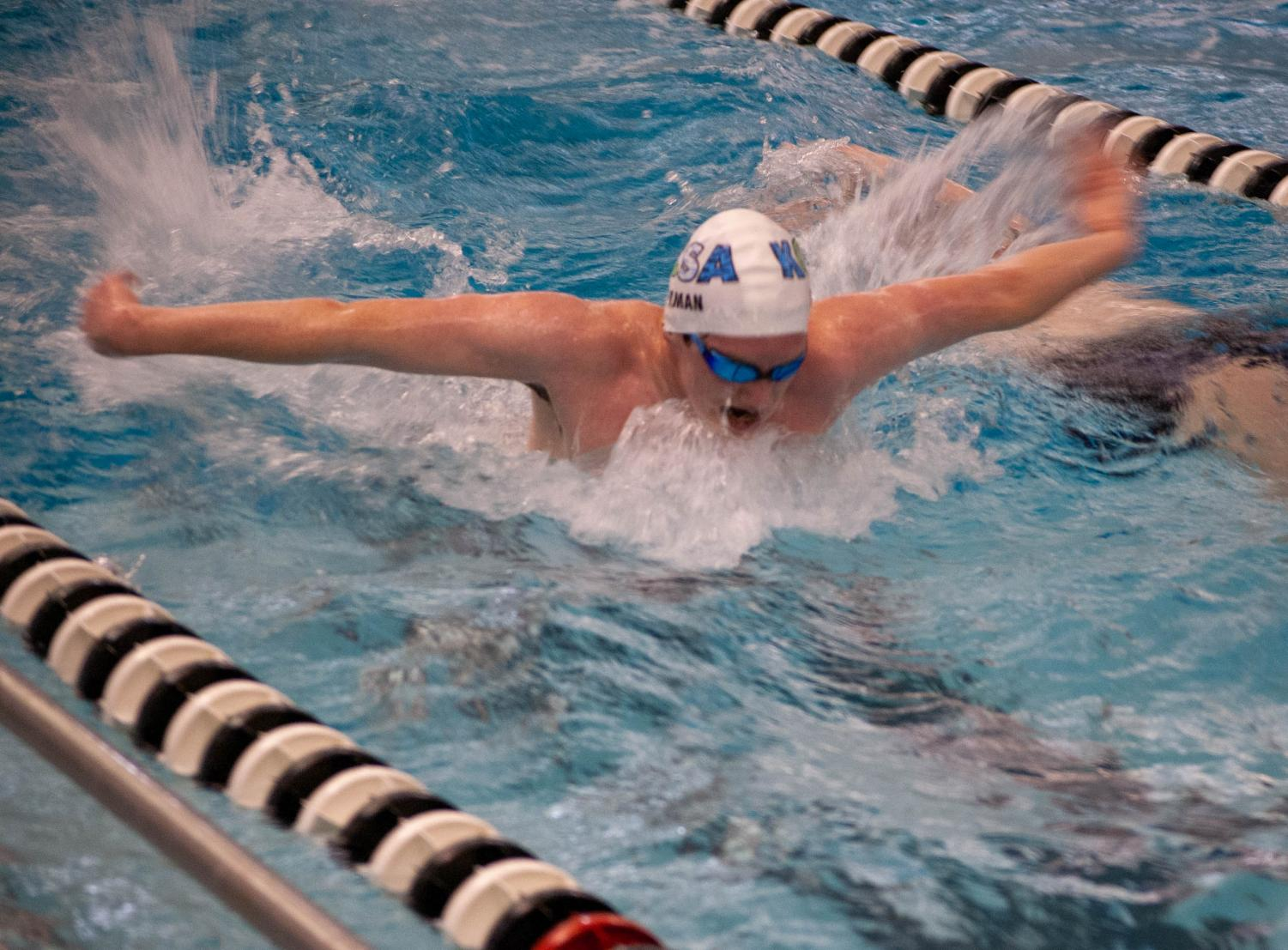 Senior Logan Beaman does a butterfly stroke while practicing.