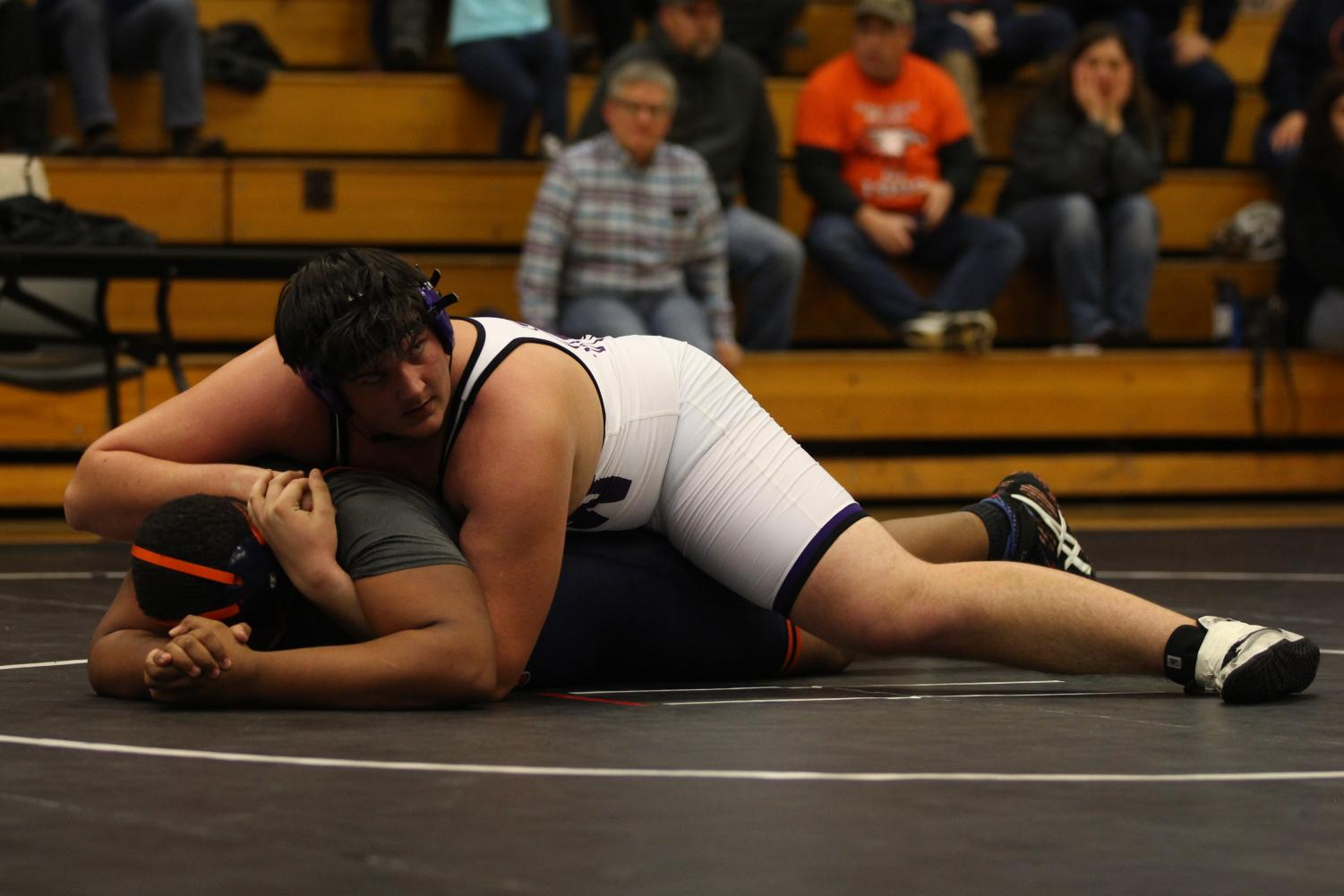 Senior Danny Robinson holds an opponent in a pin on Jan. 16.