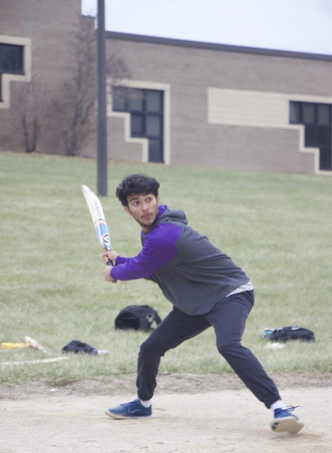 """Senior Samanyu Pusuluri swings to hit the cricket ball on, Nov. 16. """"The motto we created for this league is 'Diversity #1' which is something we all strive to follow. Playing this game allows us to reconnect back to our culture and for others they get to learn about a new one,"""" Senior captain Samanyu Pusuluri said."""