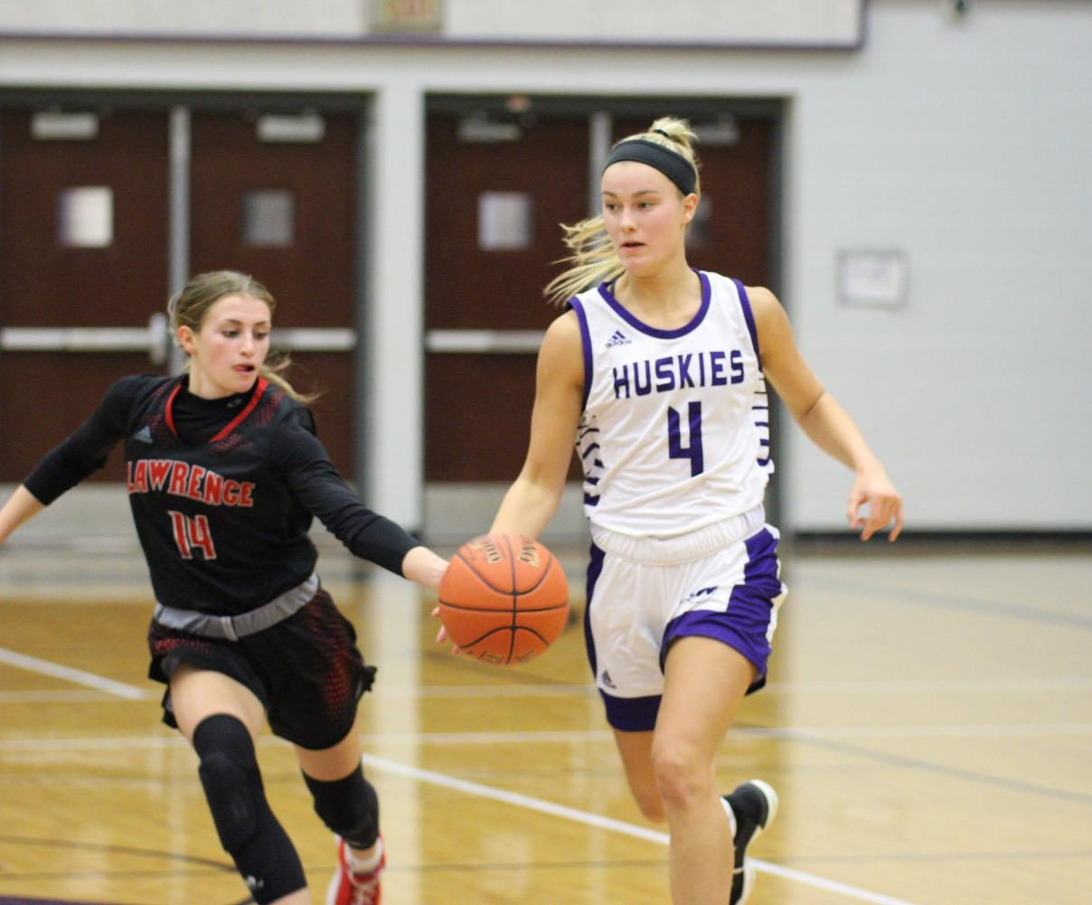 Senior Grace Coble avoids a turnover while dribbling the ball down the court.
