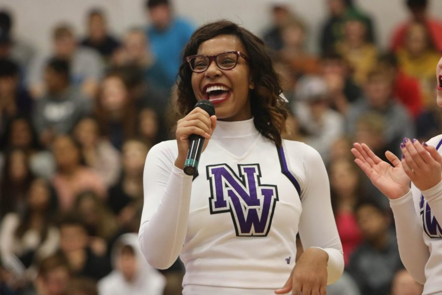 Senior cheerleading captain Jordan Nevels speaks during the cheerleading state championship assembly, on Dec. 2.