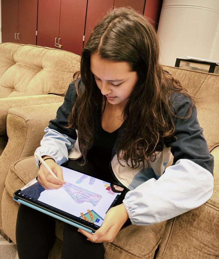 Freshman Sabrina San Agustin draws on her iPad during her sticker creating process on Nov. 15.