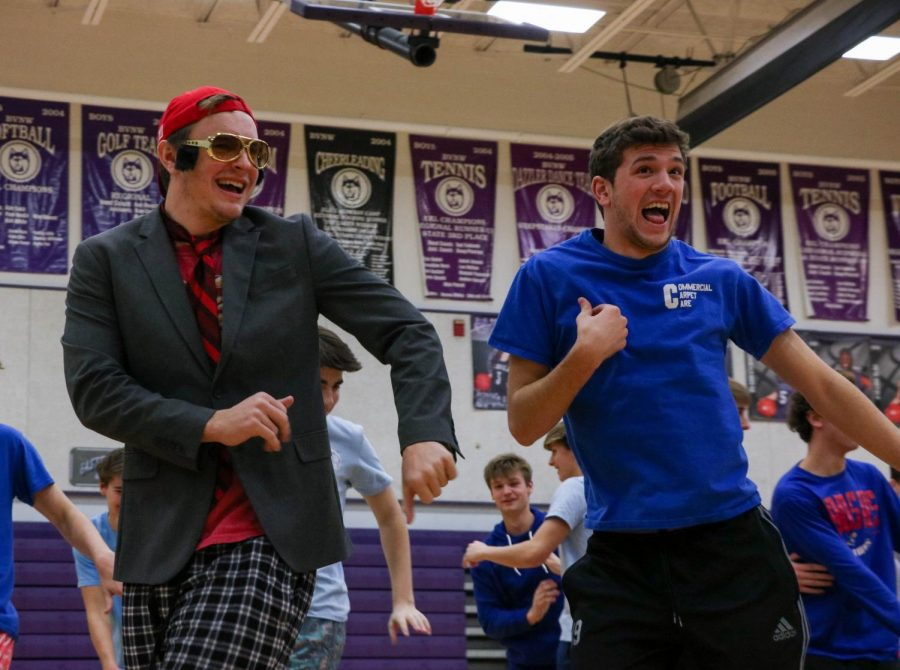 Junior Leo Clennan and senior John Fischbach dance together in the class color day spirit skit, Jan. 30.