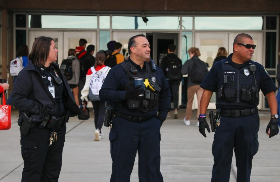 OP+Police+Officers+and+SRO+Officer+Anthony+Garcia+stand+outside+the+school+Thursday+morning+during+arrival.+