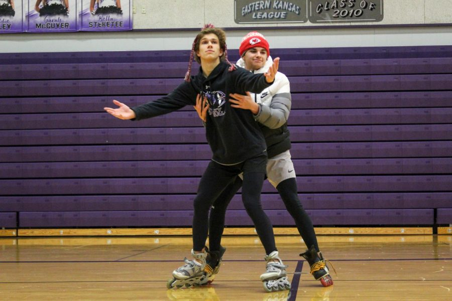 Seniors Jake Dolesh and Jackson Million dance together in the main gym during the season spirit skit, Jan. 29