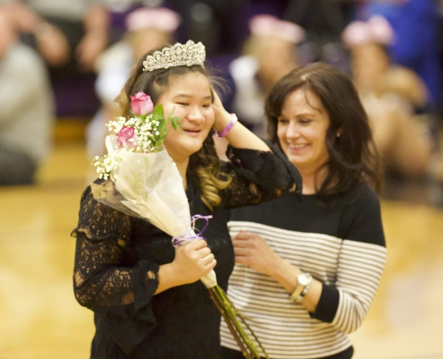 Senior Nora Story celebrates after being crowned Sweetheart Queen at the Sweetheart game against Saint Thomas Aquinas.