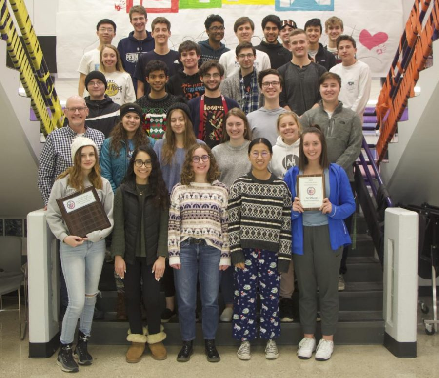 The We the People team stands together holding their state championship plaques, on Jan. 29.