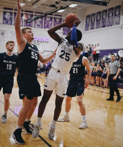 Senior Markell Hood (25) shoots a fadeaway jumper during the boys varsity basketball game.