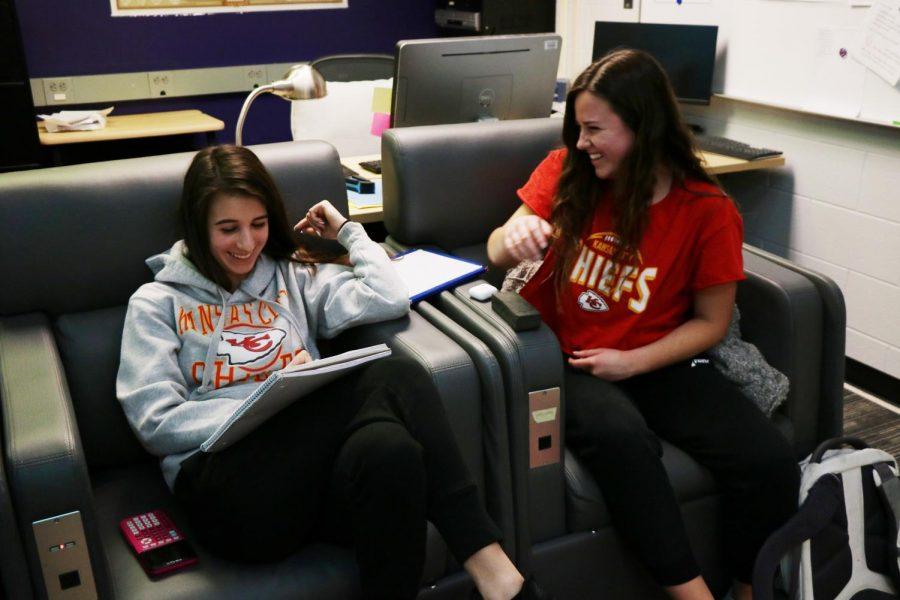 Juniors Mikayla Rakolta and Emily Moser wear Chiefs gear following the teams Super Bowl win, Feb. 2.