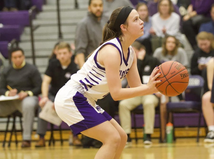 Sophomore Hayley Numrich (0) shoots a free throw to tie the game at 27 with under two minutes remaining in regulation.