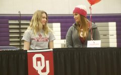 Senior Jenna Calton signs with the University of Oklahoma rowing team  at the spring athletic signing ceremony, Feb. 6.