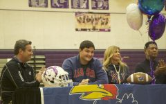 Senior Danny Robinson signs with the University of Kansas to play football during the spring athletic signing ceremony, Feb. 6.