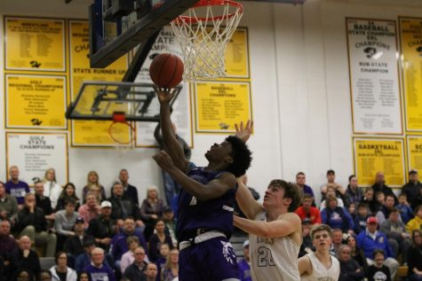 Junior Alston Mason (1) attempts a layup to give the Huskies a five point cushion late in the fourth quarter.