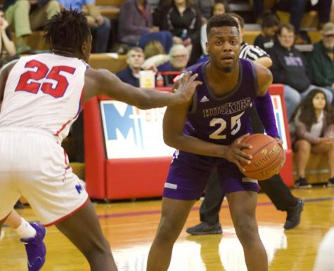 Senior Markell Hood (25) prepares to pass the ball to the wing in a 70-56 win over Bishop Miege.