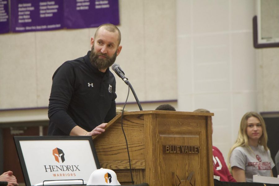 Football coach Clint Rider speaks during the spring athletic signing ceremony, Feb. 6.