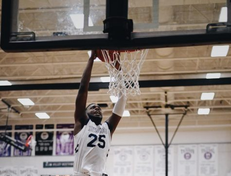 Senior Markell Hood (25) rises up to dunk the ball in the team's substate semifinal game