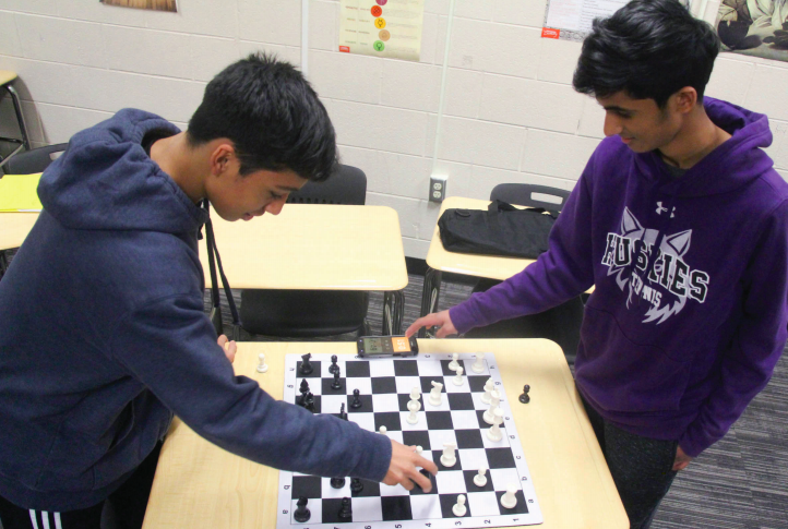 "Ankith Sheshappa (right) plays a game of chess with sophomore Alex Mojica (left) Jan. 15. ""Chess in general has been beneficial to my mental strength,"" Sheshappa said."