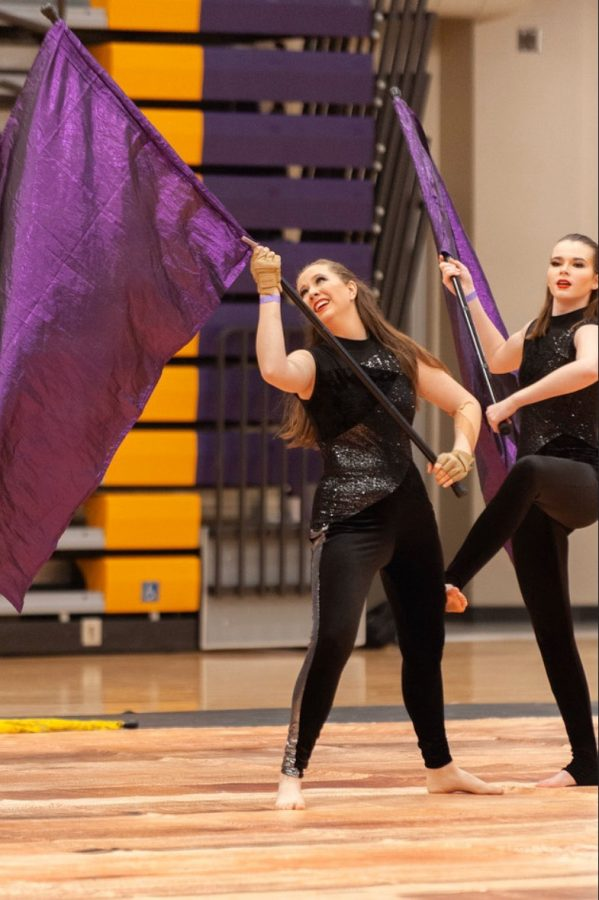 Junior Annie Fischer performs with BVSW during a winterguard performance.