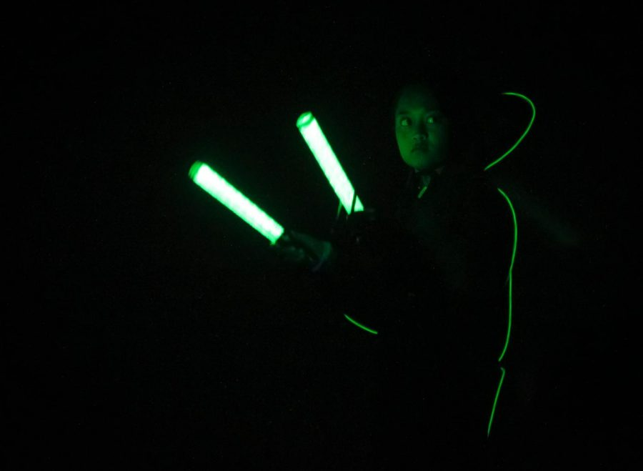 A Howlin' Husky marching band drum major participates in the annual Glow Show, Nov. 2.
