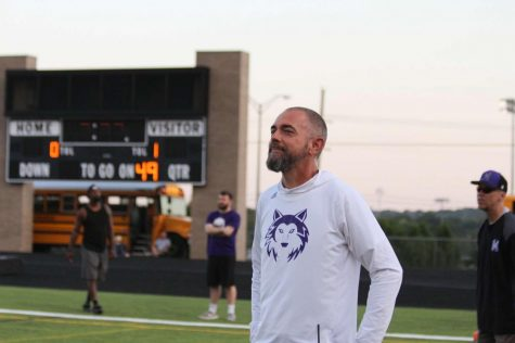 Athletic Director Kevin Gerke smiles as he watches a Northwest football game.