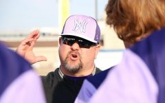Former varsity baseball coach Jade Samborski talks to the baseball team during a game against Lee Summit West on March 18, 2019.