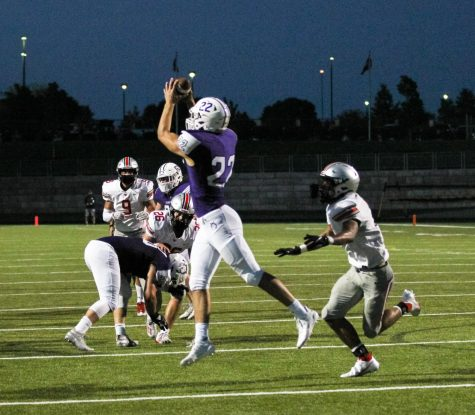 Junior Drew Kaufman jumps to successfully catch a pass during the varsity football game against BVW.