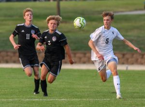 Sophomore Sam McIntosh (3) and senior Ethan Hunt (11) chase the ball in the boys varsity soccer game, Sept. 17.