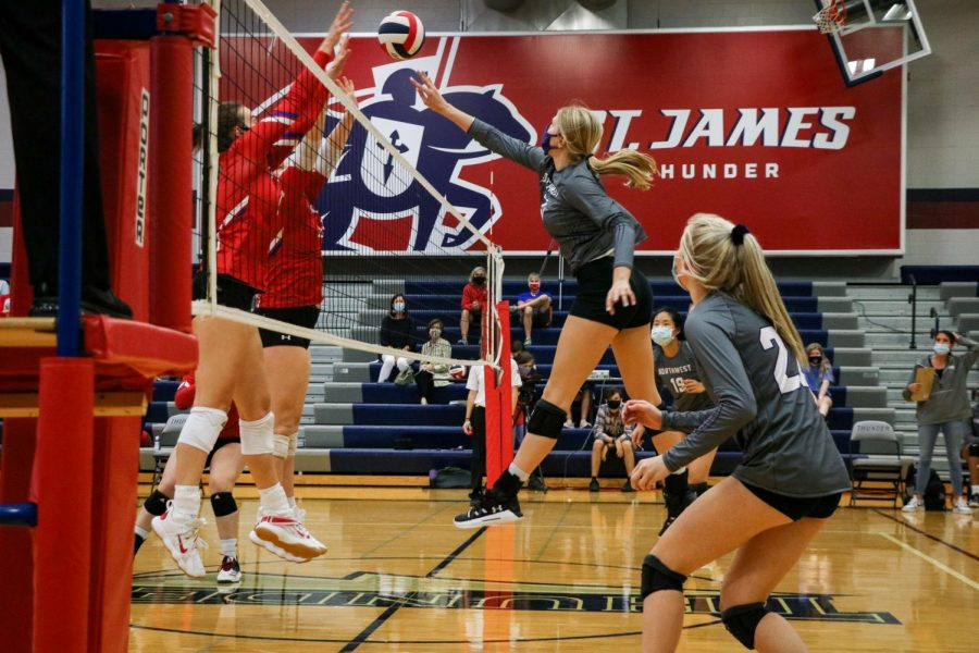 Senior Maddie Clark goes to block in the match against Saint James Acadamey, Sept. 17.