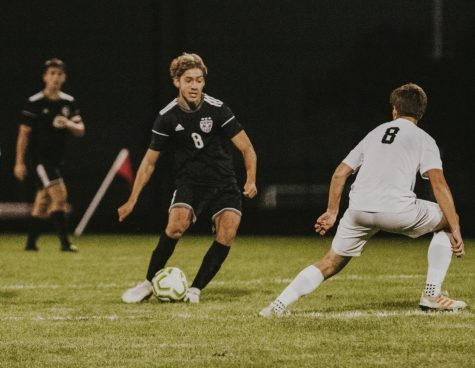 Senior Fitz Horn makes a move on the defender.