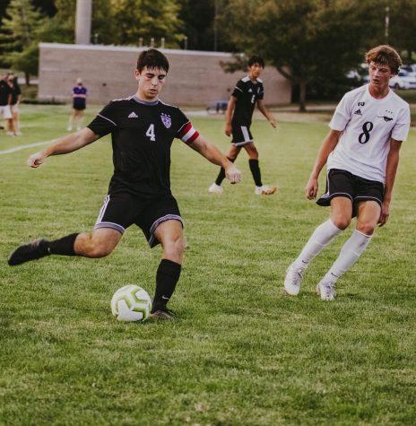 Senior Will Vancrum passes the ball in the boys varsity soccer game, Sept. 25.