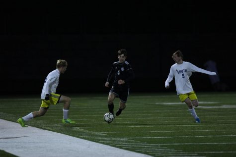 Current senior Will Vancrum dribbles the ball during the varsity substate game on Oct. 29 2019
