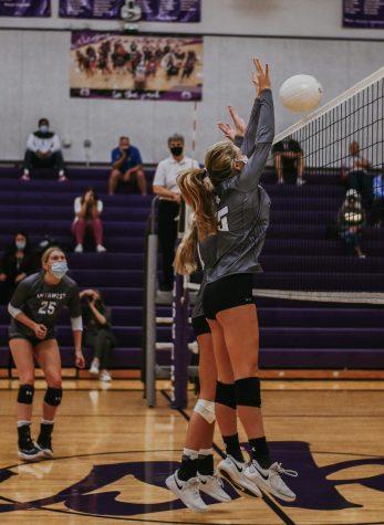 Senior Lauren McCarty blocks the ball against Blue Valley, Oct. 1.