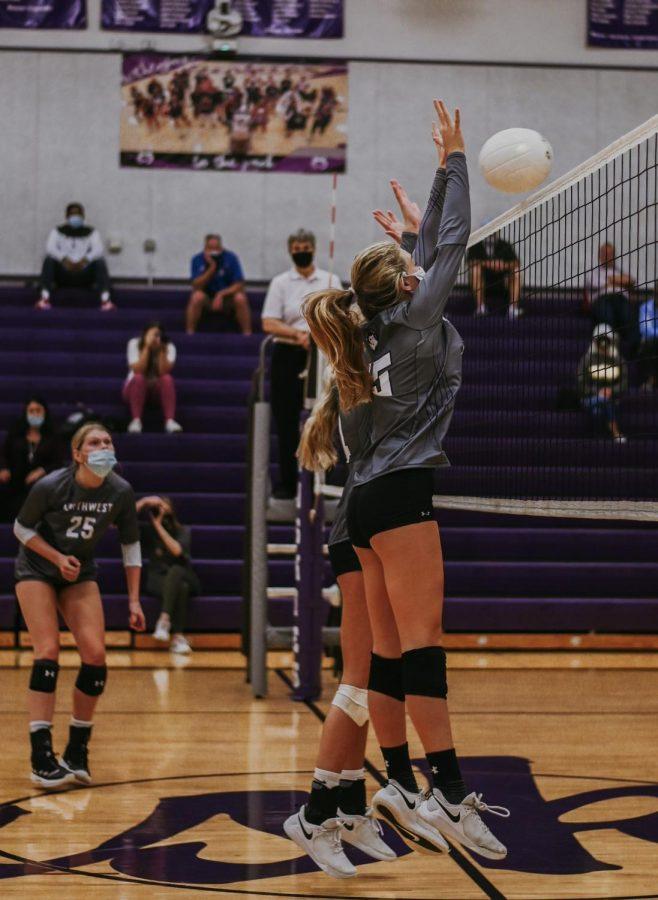 Senior+Lauren+McCarty+blocks+the+ball+against+Blue+Valley%2C+Oct.+1.