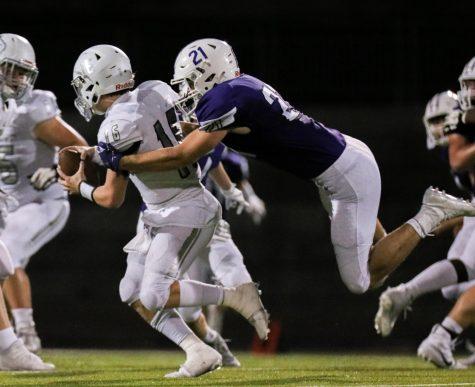 Senior Leo Clennan sacks the quarterback against Blue Valley North, Oct. 9.