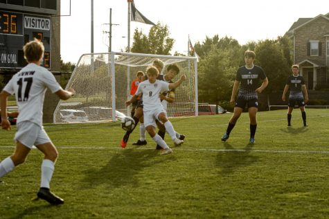 Senior Fitz Horn (8) plays offense against the Mustangs.