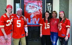Jeremy, Paul, Laura, Lisa, and Lily Bredemeier pose outside their house after they had finished putting up decorations for their Super Bowl party. Feb. 2.