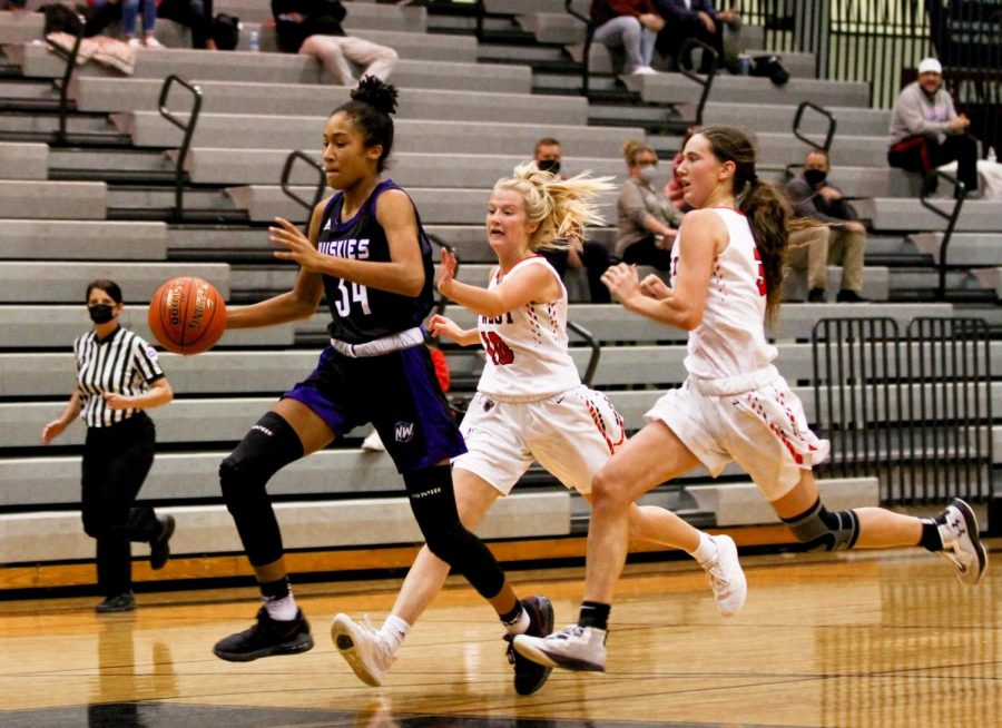 Freshman Lanie Douglas dribbles down the court at the game against Blue Valley West, Jan. 8.