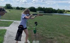 Junior Lexi Liess practices trap shooting with her father, Rich Liess.