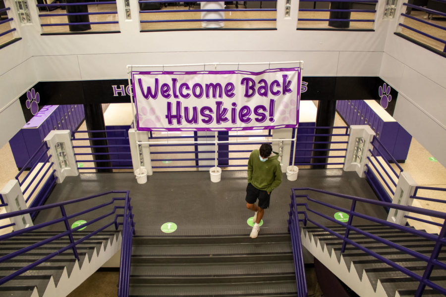 A welcome sign hangs in the main staircase to welcome students back into the building, March 23.