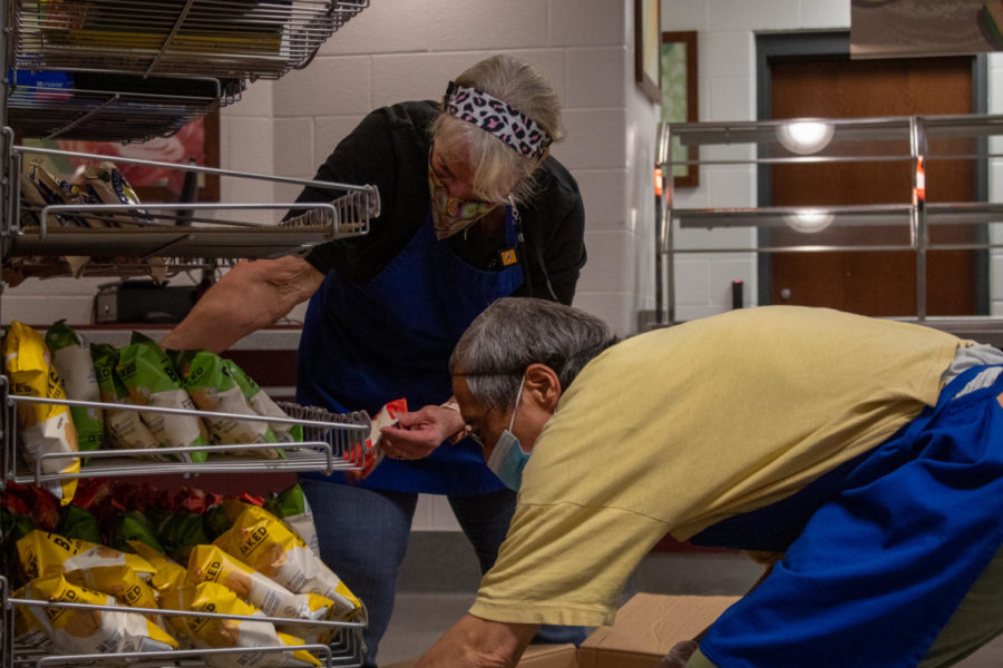 Cafeteria workers put out chips to be purchased, as students say they ran out of student meals, March 23.